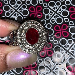 Red stone trimmed in bling